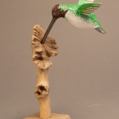wooden-painted-woodpecker-on-parasite-wood