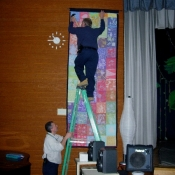 Hanging the Finished Folkshul Batik Quilts at Springside School
