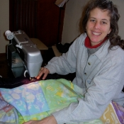 Laura Sewing the Folkshul Batik Quilts