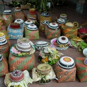 Balinese Offering Baskets Awaiting Blessings from the Priestt