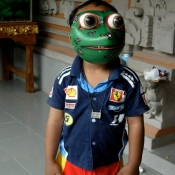 Young Wayan in Frog Mask