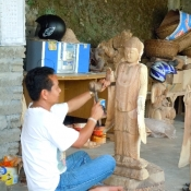 carving-tall-wooden-buddha